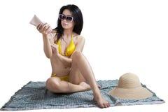 Woman applying moisturizer Stock Photo