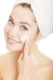 Woman applying moisturizer cream stock photo