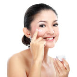 Woman applying moisturizer cream Stock Photography