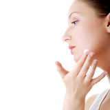 Woman applying moisturizer cream on face. Close-up fresh woman face Royalty Free Stock Images