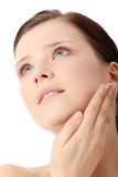 Woman applying moisturizer cream on face Royalty Free Stock Image