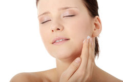 Woman applying moisturizer cream on face Royalty Free Stock Photos