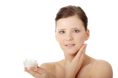 Woman applying moisturizer cream on face Royalty Free Stock Photo