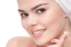 Woman applying moisturizer cream on face Royalty Free Stock Photography