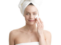 Woman applying moisturizer cream on face royalty free stock photo