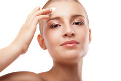 Woman applying moisturizer cream on face isolated Royalty Free Stock Photography