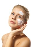 Woman applying moisturizer cream on face isolated Stock Photos