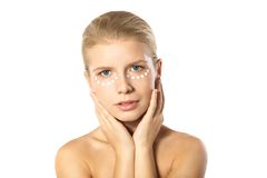 Woman applying moisturizer cream on face isolated Royalty Free Stock Photos