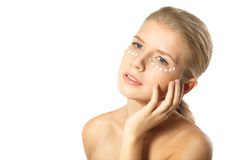 Woman applying moisturizer cream on face isolated Stock Image