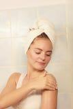 Woman applying moisturizer cream on her body Royalty Free Stock Image