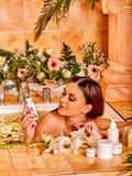 Woman applying moisturizer Stock Image