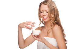 Woman applying moisturizing cream Stock Photos
