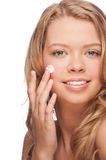 Woman applying moisturizing cream Royalty Free Stock Photo