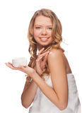 Woman applying moisturizing cream Stock Images