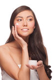 Woman applying moisturizing cream Royalty Free Stock Image