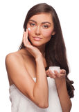Woman applying moisturizing cream Royalty Free Stock Images