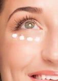 Woman applying moisturizing cream Royalty Free Stock Photos