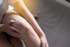 Woman applying moisturizing cream on her leg,Concept healthy and skin. Woman applying moisturizing cream on her legs,Concept healthy and skin Stock Image