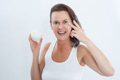 Woman Applying Moisturizing Eye Cream to Face Royalty Free Stock Photos