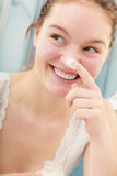 Woman applying moisturizing skin cream. Skincare. Stock Photography