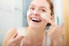 Woman applying moisturizing skin cream. Skincare. Stock Image