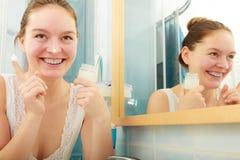 Woman applying moisturizing skin cream. Skincare. Royalty Free Stock Images