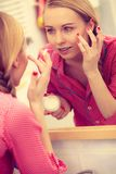 Woman applying moisturizing skin cream. Skincare. Stock Image