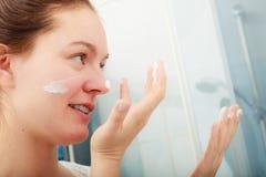 Woman applying moisturizing skin cream. Skincare. Royalty Free Stock Image