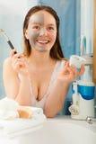 Woman applying mud facial mask Royalty Free Stock Photos
