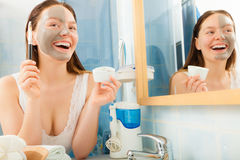 Woman applying mud facial mask Royalty Free Stock Photography