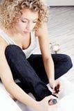 Woman applying nail polish Stock Image