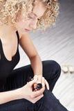 Woman applying nail polish Stock Images