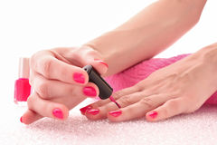 Woman applying  nail polish Stock Image