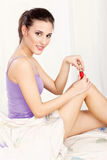 Woman applying nail polish Royalty Free Stock Photos