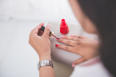 Woman applying nail polish into her nail Royalty Free Stock Photo