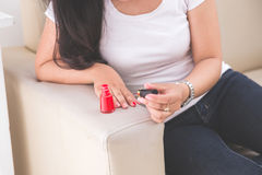 Woman applying nail polish into her nail Royalty Free Stock Photography