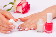Woman applying nail polish Royalty Free Stock Photos