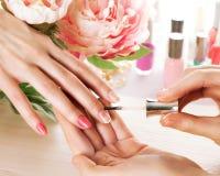 Woman applying nail varnish to finger nails Royalty Free Stock Photos
