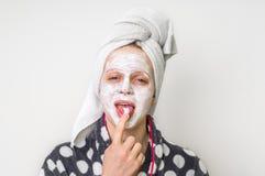 Woman applying natural facial mask from sour cream stock photos