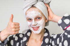 Woman applying natural facial mask from sour cream royalty free stock images