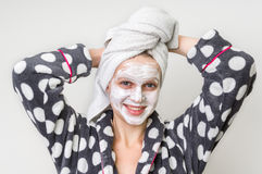Woman applying natural facial mask from sour cream Stock Image
