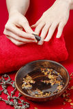 Woman applying natural looking nail polish Stock Photography