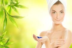 Woman applying organic cosmetic stock photos