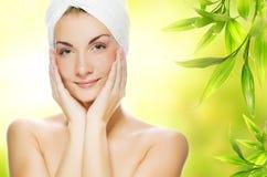 Woman applying organic cosmetics stock image