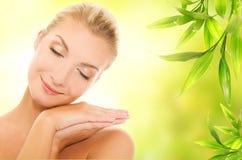 Woman applying organic cosmetics Royalty Free Stock Photos