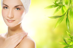 Woman applying organic cosmetics Stock Photo