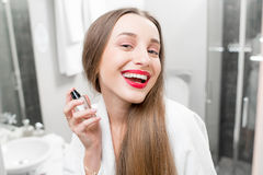 Woman applying parfumes Stock Images