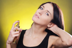Woman applying perfume Royalty Free Stock Images