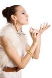 Woman applying perfume Royalty Free Stock Photos