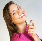 Woman applying perfurme on her neck Stock Image